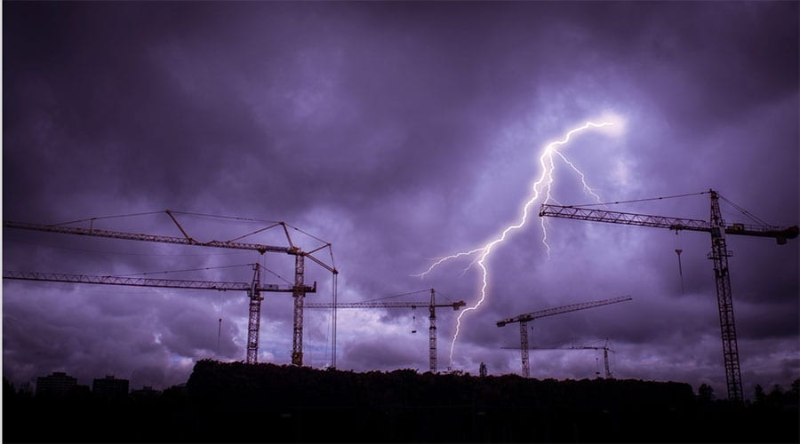 A lightning strike over a construction site.